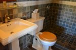 Slate Tiles, Walk in Shower, Pedestal Sink and Plush Towels