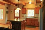 Open country kitchen with gas range