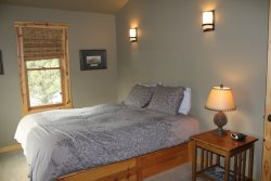 Sisters Oregon cabin vacation rentalMaster bedroom with queen bed
