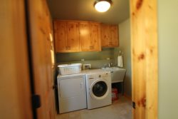 Laundry room with full size machines and half bath on main level