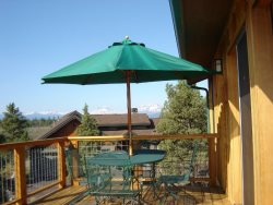 Savor meals al fresco at this Sisters Vacation Cabin rental deck