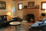 Fish Inn Bike Inn Sisters Vacation Home, cozy living room with wood burning fireplace