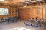 Garage Room fixed as game room with Ping Pong Table, Bikes ect