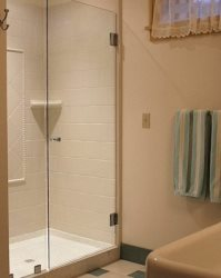 Full bath with shower\/laundry room in basement
