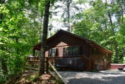ETOWAH: Adorable 2BR/1BA Cabin! Hot Tub, Dog Friendly, Wood Burning Fireplace, Satellite TV, Charcoal Grill, Sleeps 4, Starting At $79/night!