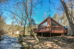 CREEKSIDE RETREAT: Beautiful 2BR/1.5BA Cabin On Wilscot Creek (a trophy trout stream), WiFi, Roku TV, Hot Tub, Wood Burning Fireplace, Outdoor Fire Pit, Large Yard, Gazebo,  Huge Deck Overlooking Creek, Sleeps 6, Starting At  $145/night!