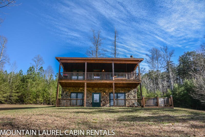 KINGDOM CABIN #2  3BR/2BA  TOTALLY SECLUDED CABIN WITH CREEK SLEEPS 8, HOT  TUB, CHARCOAL GRILL, FIREPLACE, FIRE PIT, AND PET FRIENDLY!