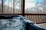 HOT TUB ON LOWER LEVEL PORCH