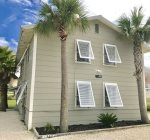Sandy exterior with Bahama shutters