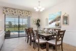 The formal dining table seats 10 for the whole family to enjoy meals together