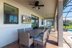 Dine underneath the covered lanai at the outdoor table with seating for 8