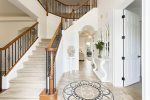 Grand sweepping staircase and incredible foyer greet you as you enter