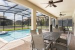 Two outdoor dining tables with overhead fans perfect for enjoying meals al fresco