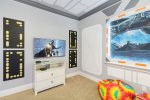 Watch TV from your bed in this kids room