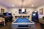 Play all day long in the custom games room with multiple arcades, slate pool, foosball table