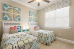 Colorfully decorated kids room with double twin beds