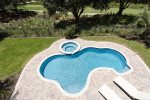 Gorgeous pool with spa right next to the golf course