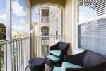 Screened balcony with comfortable patio furniture