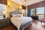 Stately upstairs master suite bedroom 3 features direct balcony access and amazing golf views