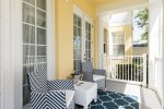 The corner of the wrap around porch has seating for two to relax in privacy