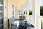 This amazing wraparound porch has ample outdoor seating to enjoy the beautiful views and amazing Florida weather