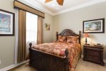 The second master bedroom is located on the first floor and offers a queen sized bed and ensuite bathroom
