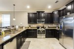 The fully equipped kitchen has brand new appliances