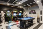 The games room has multiple arcade games for everyone to enjoy