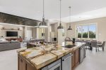 The kitchen has custom cabinetry and granite counter tops and top of the line appliances