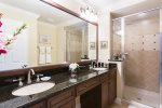 The spacious master bathroom