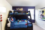 Mickey Mouse bedroom with a twin over bottom bunk bed