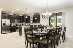 The open kitchen and dining area is great for your vacation