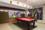 Enjoy a game of pool in this fun games room