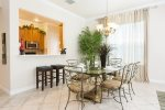 Open concept dining and kitchen make it convenient for family meals