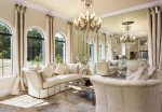 This gorgeous sitting area has natural sunlight and a wall of mirrors to create an open feeling