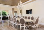 The formal dining table under a gorgeous crystal chadelier
