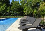 There are plenty of sun loungers by your south facing pool