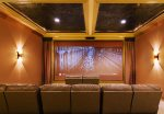 The private cinema with 185 inch screen and surround sound