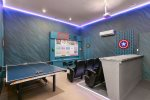 The games room features a retro arcade machine, pool table and table tennis