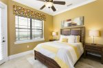 This ground floor queen bedroom has a private entry and overhead fan