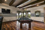 Play a game of pool in the second floor games area with views of the golf course