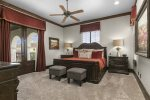 Second floor master bedroom with a king bed and overhead ceiling fan