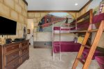 This bedroom features full/full bunk bed and a twin bed extension