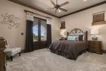 This master bedroom has a queen bed and French doors out to the balcony