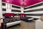 Little girls will love the themed Hello Kitty twin bedroom