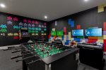 Enjoy a multi-arcade system, foosball table and video game systems
