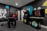 Play games with the whole family in this classic arcade game room