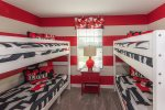 This fun bedroom features 2 twin over twin bunk beds