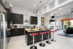 The spacious kitchen features stainless steel appliances