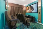 The ground floor also a private theater room with a 92-inch projection screen